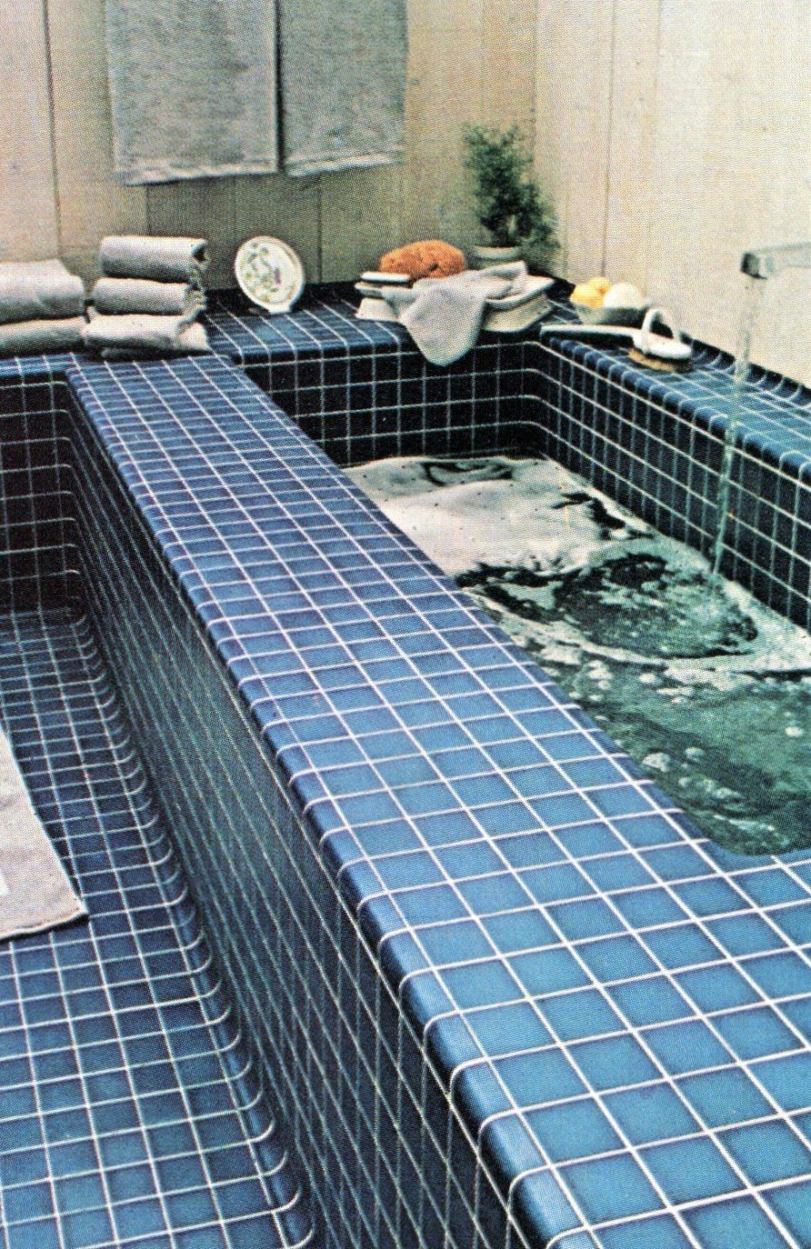 Blue ceramic tile surround on a bathtub (1981)