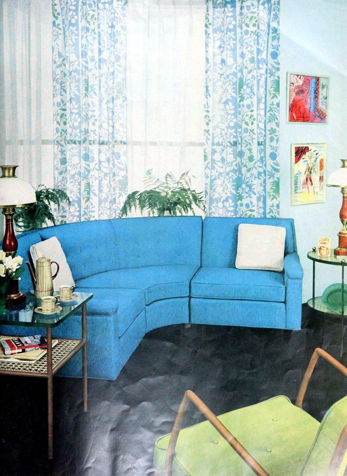 Blue curved sofa dominates this retro room