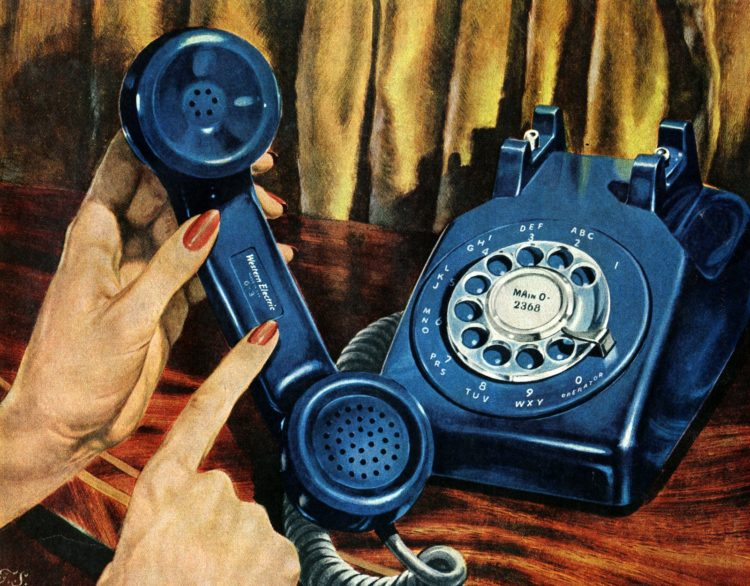 Blue rotary dial telephone from 1956