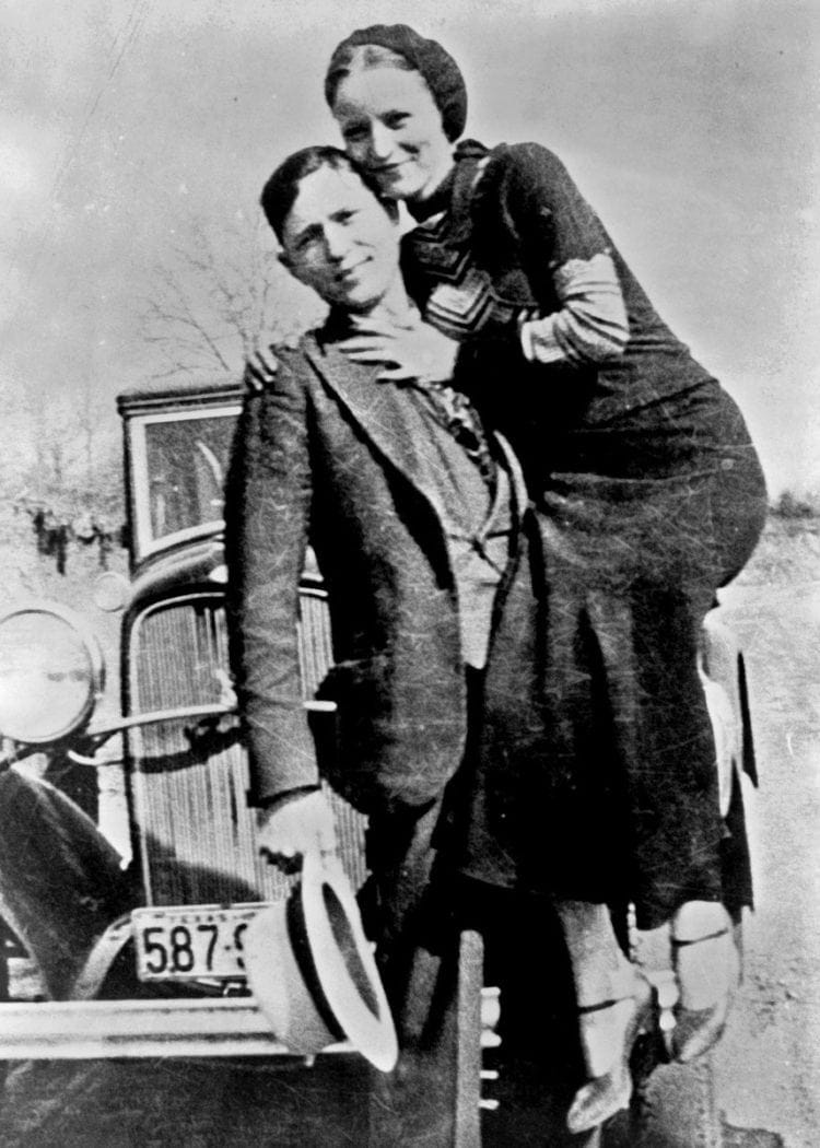 Bonnie and Clyde with their car