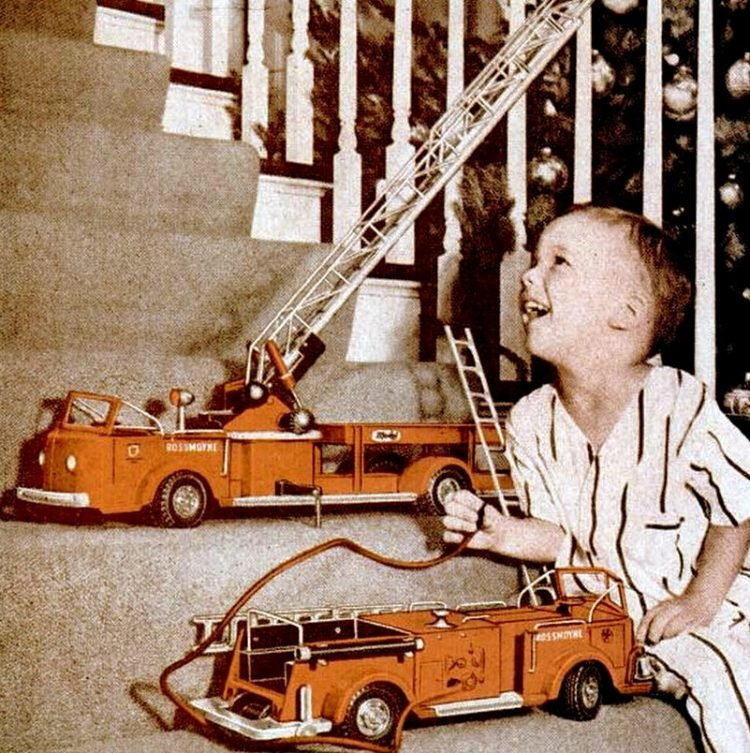 Boy with firetruck Christmas gift in 1953