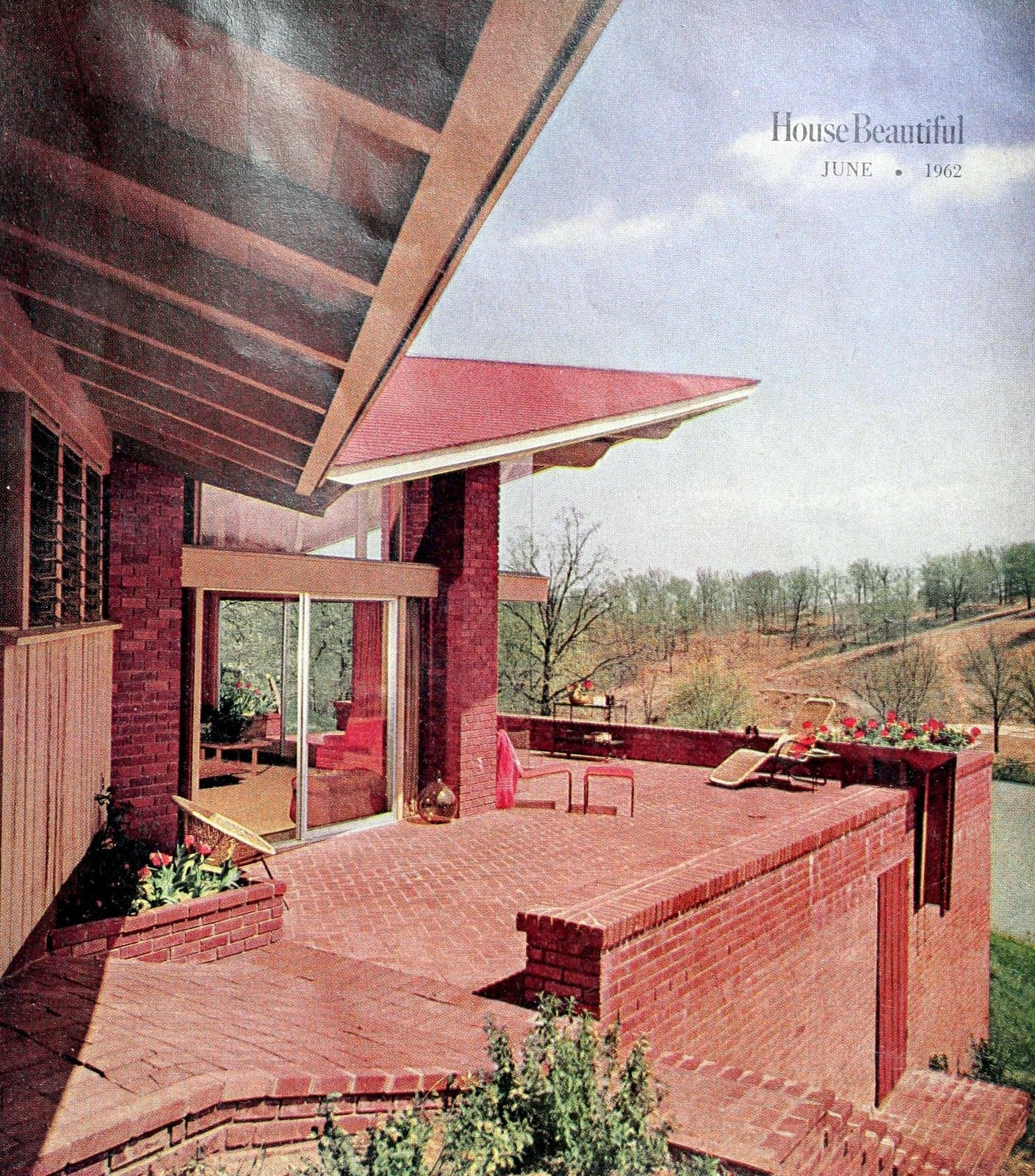 Brick terraced backyard and decking, with angled views of the home (1962)