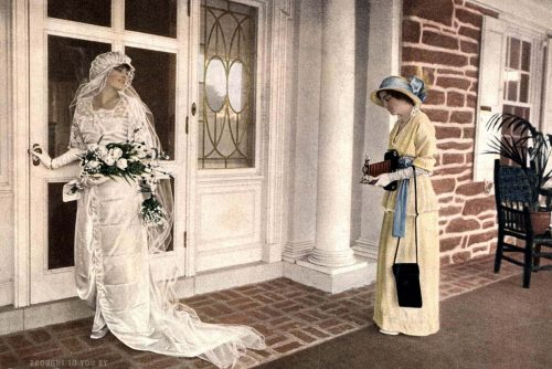 Bride from 1914 having her picture taken with a Kodak camera