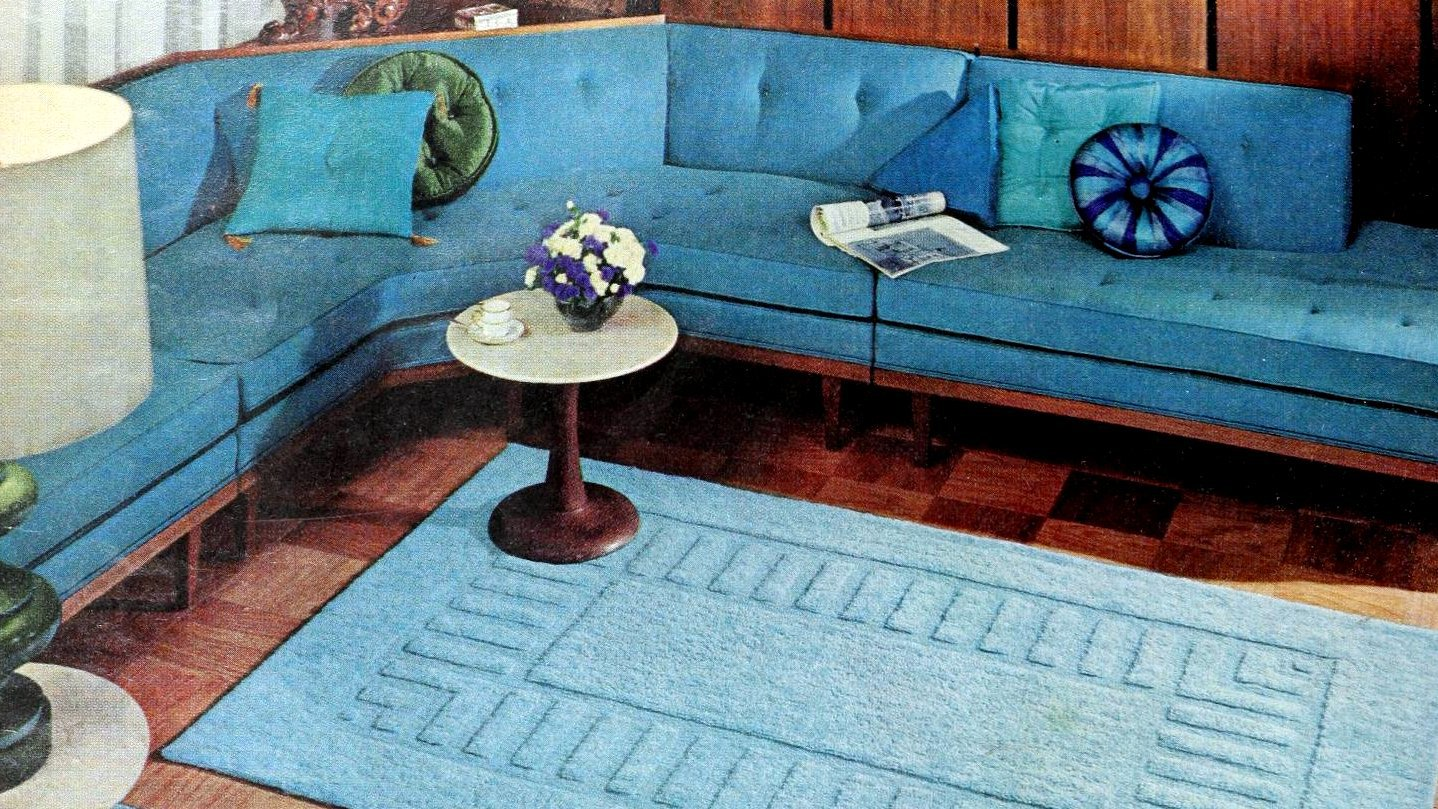 Bright blue midcentury-modern corner sofa vintage 1960s living room style