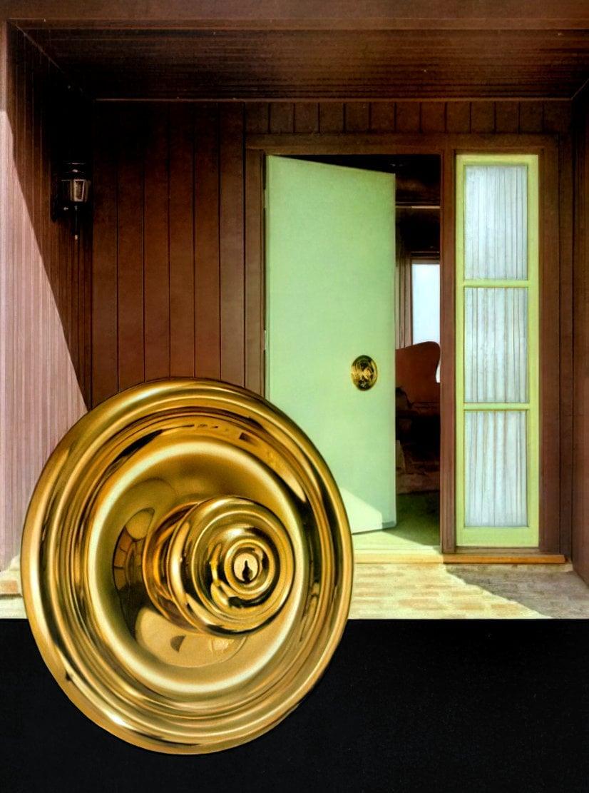 Bright brass vintage Schlage Pantheon design door handle and escutcheon