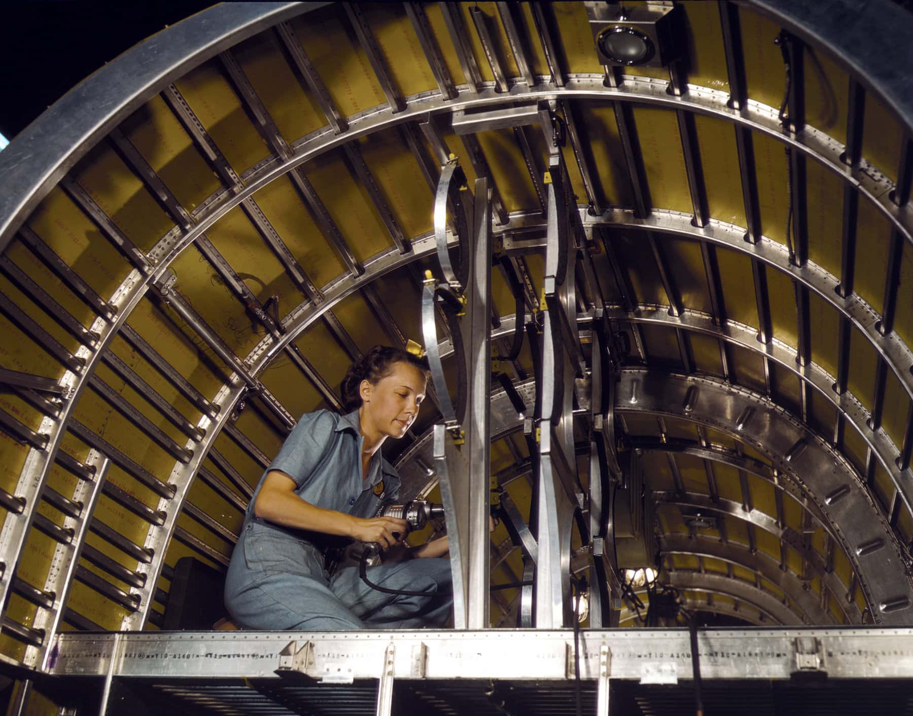 Building WWII fighter planes in the 1940s - Installing oxygen racks