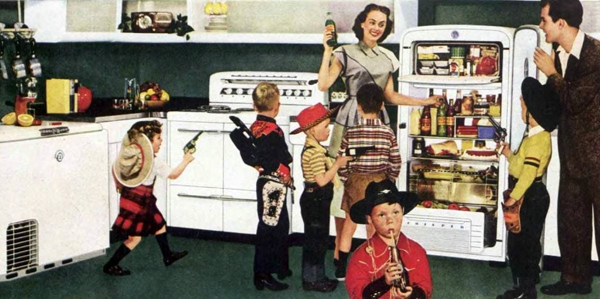 Busy family with kids in the kitchen - 1950