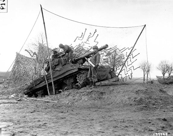 Camouflaged tank - 1945 Battle of the Bulge, from US DOD