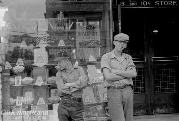 Two boys standing in front of candy store window in Circleville, Ohio during the summer of 1938