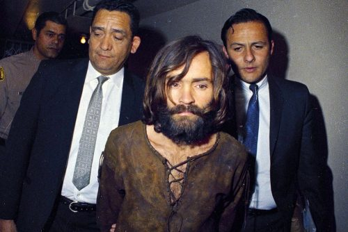 Image: Charles Manson being escorted to his arraignment on conspiracy-murder charges in 1969.