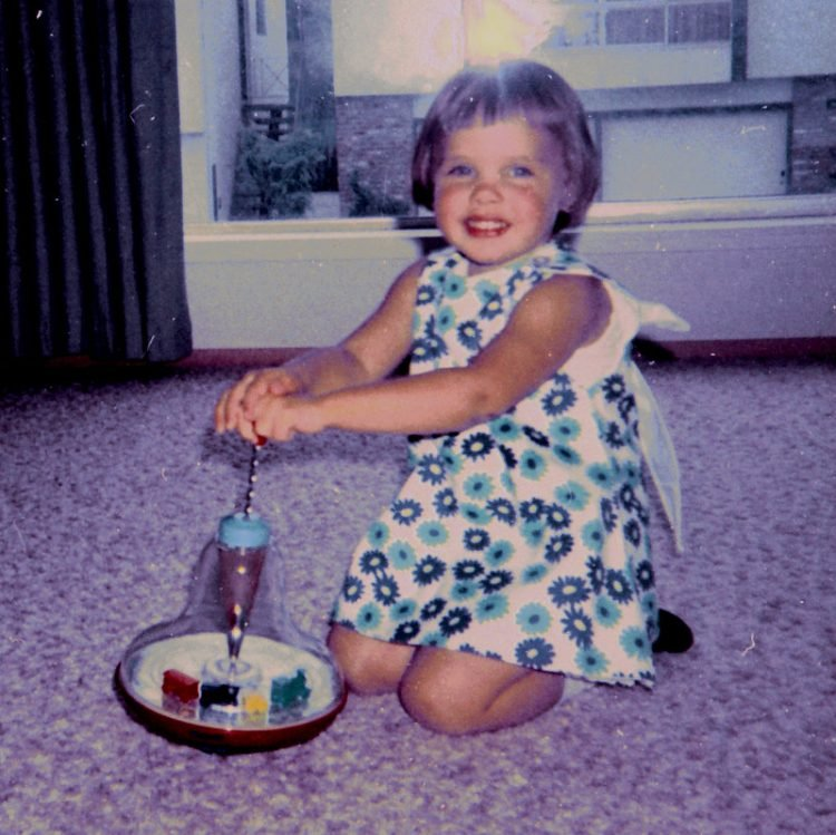 Circling train top toy with little girl - Vintage photo
