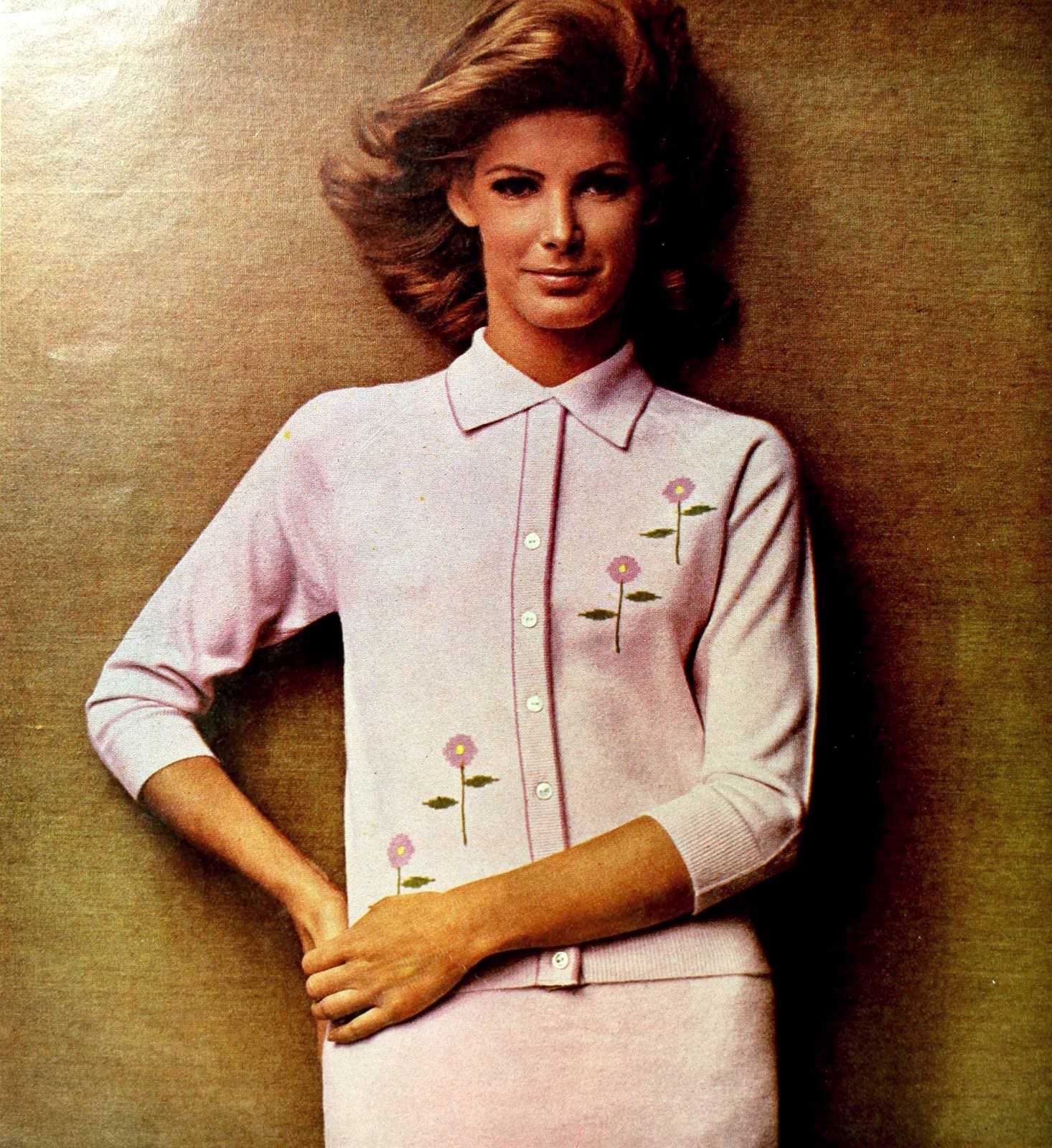 Classic stylish pink cardigan sweater with flower designs stitched on (1965)