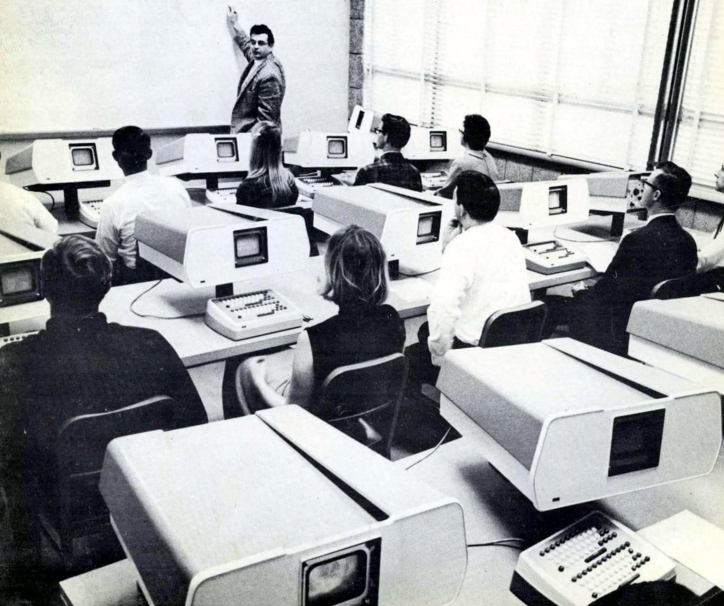 Classroom full of early computers (1966)