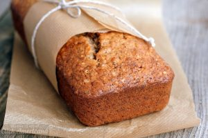 Banana bread in baking paper on table
