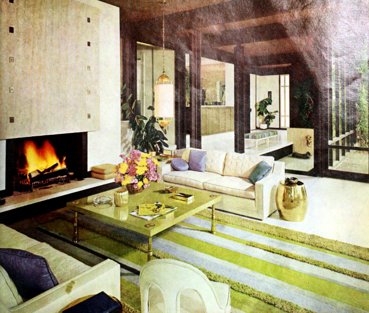Cozy decorator style in a sixties home with a marble-clad fireplace (1966)