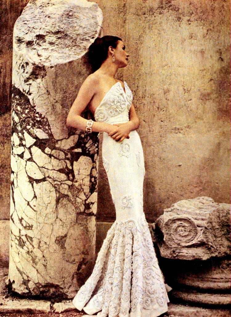 Cream-colored mermaid dress with decorative needlework from 1950