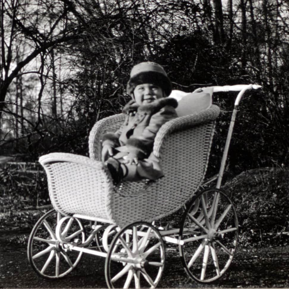 Cute baby in his carriage (1917)