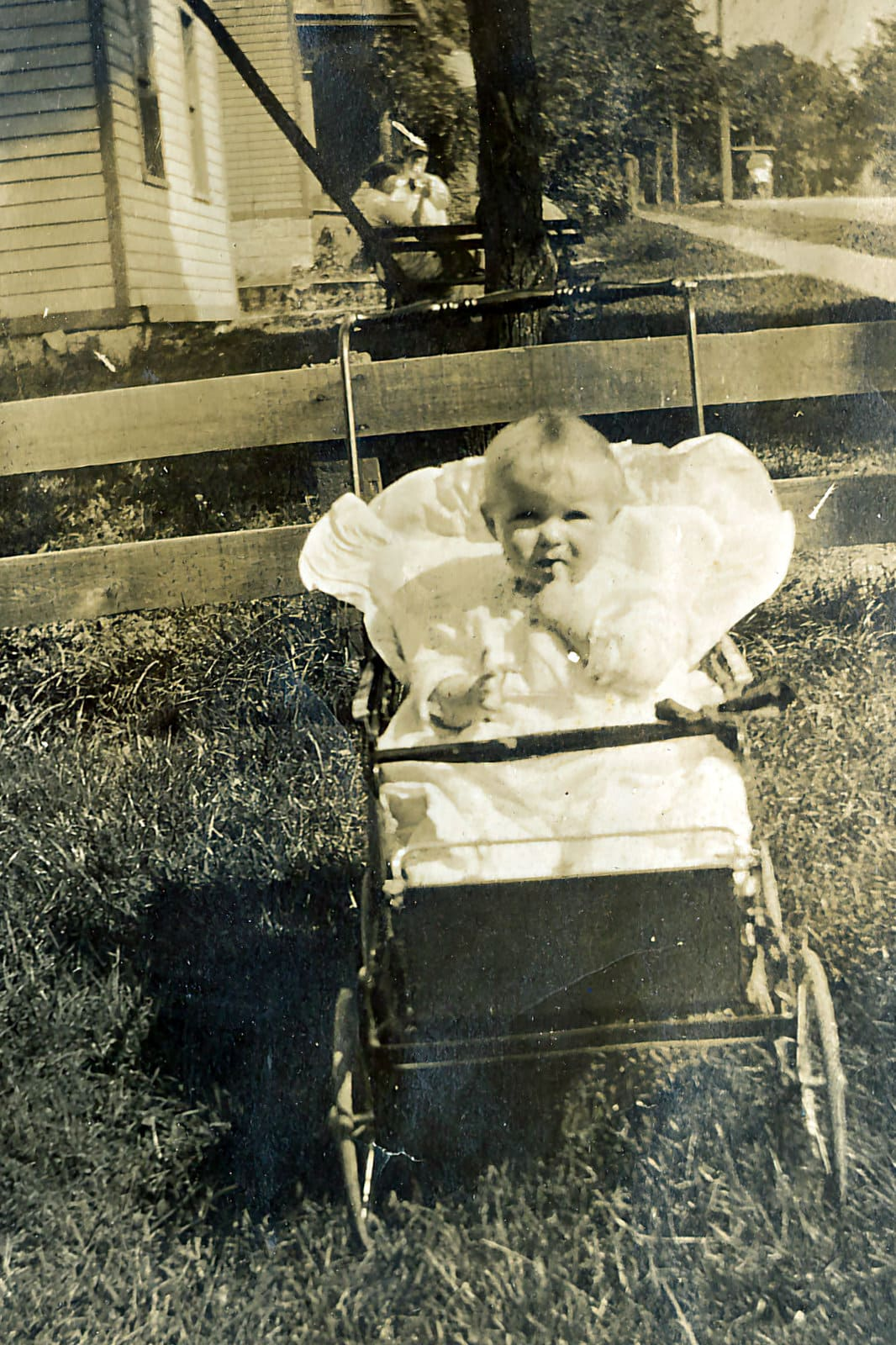 Cute girl in an early baby carriage (c1914)