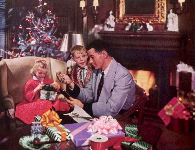 Dad and kids with Christmas gift for mom in the 1950s
