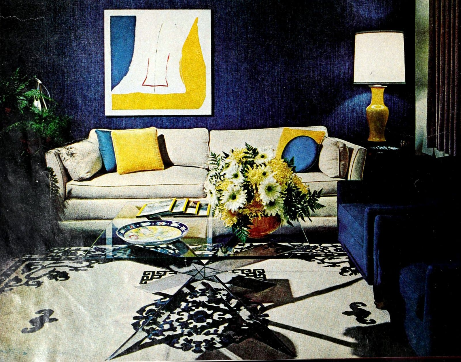 Dark blue vintage 1960s living room decor with yellow accents