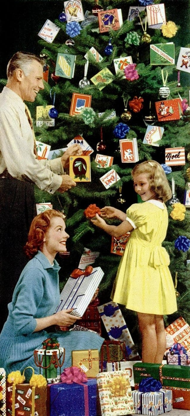 Decorating the Christmas tree with gifts in 1953