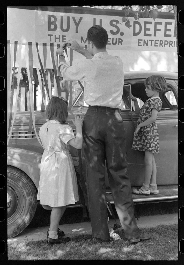 Decorating their automobile for the Fourth of July parade