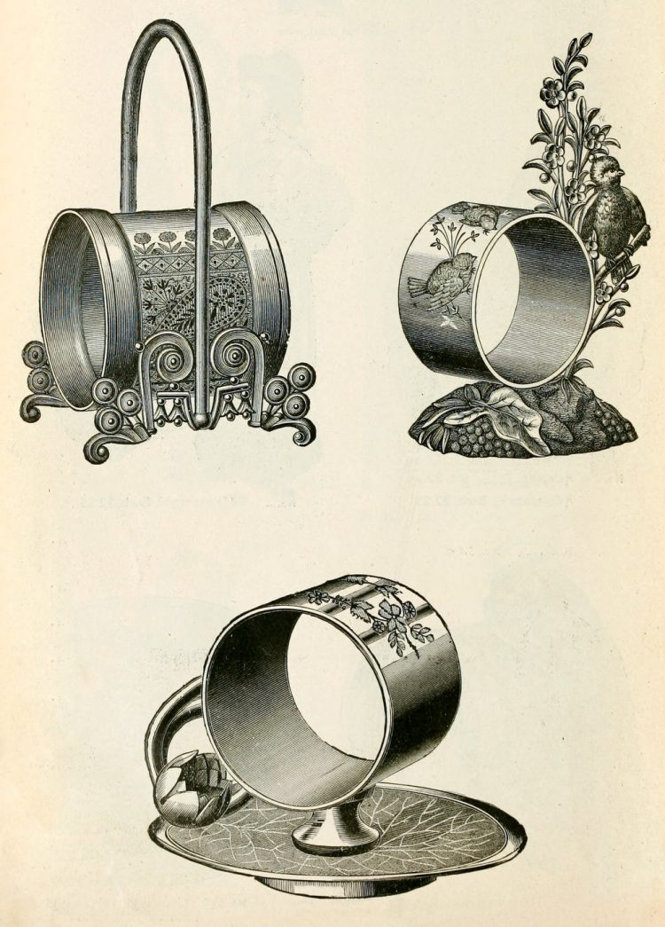Decorative antique silver napkin holders - rings
