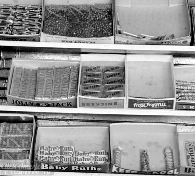 Display of candy in a store window in La Forge, Missouri -- August 1938