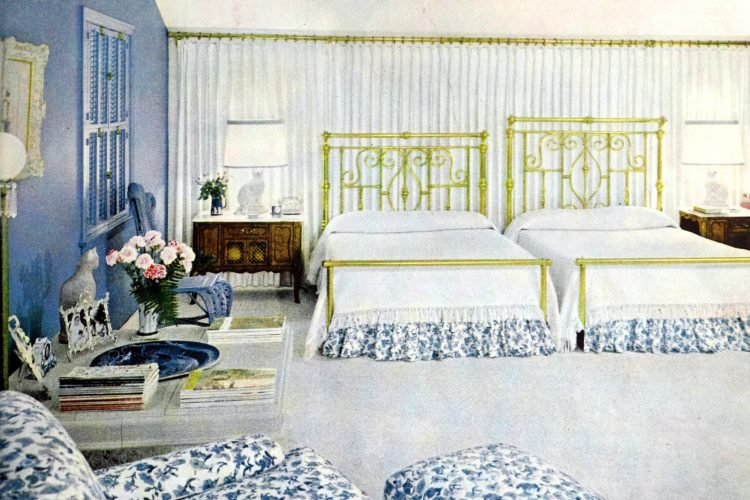 Double queen size beds in retro 50s bedroom with white and blue color scheme