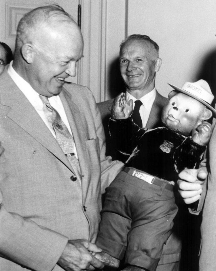 Dwight Eisenhower with Smokey the Bear teddy bear
