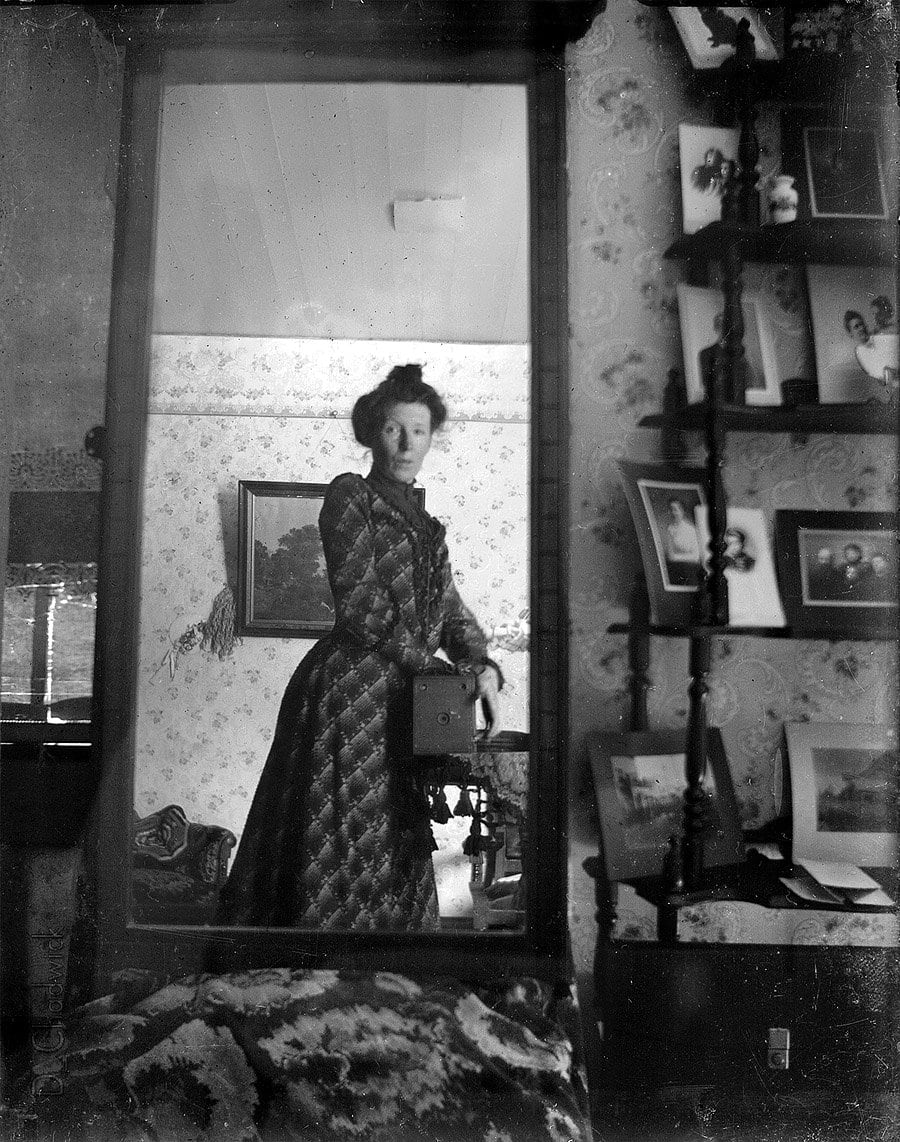 Early selfie - Unidentified woman taking her own photograph using a mirror and a box camera, roughly 1900 at ClickAmericana com