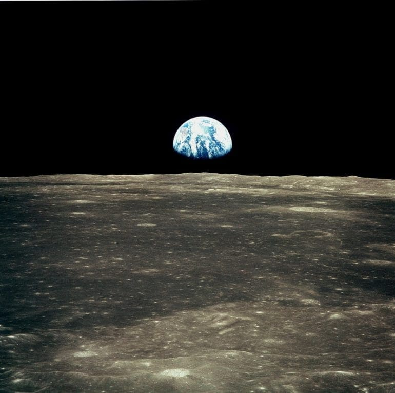 Earth view from the Apollo 11 spacecraft over the moon