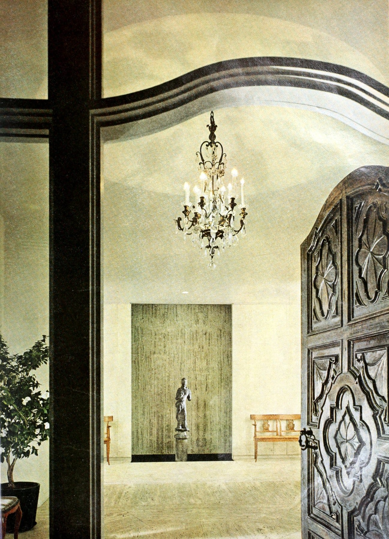 Elegant marble foyer with carved wooden front door (1964)