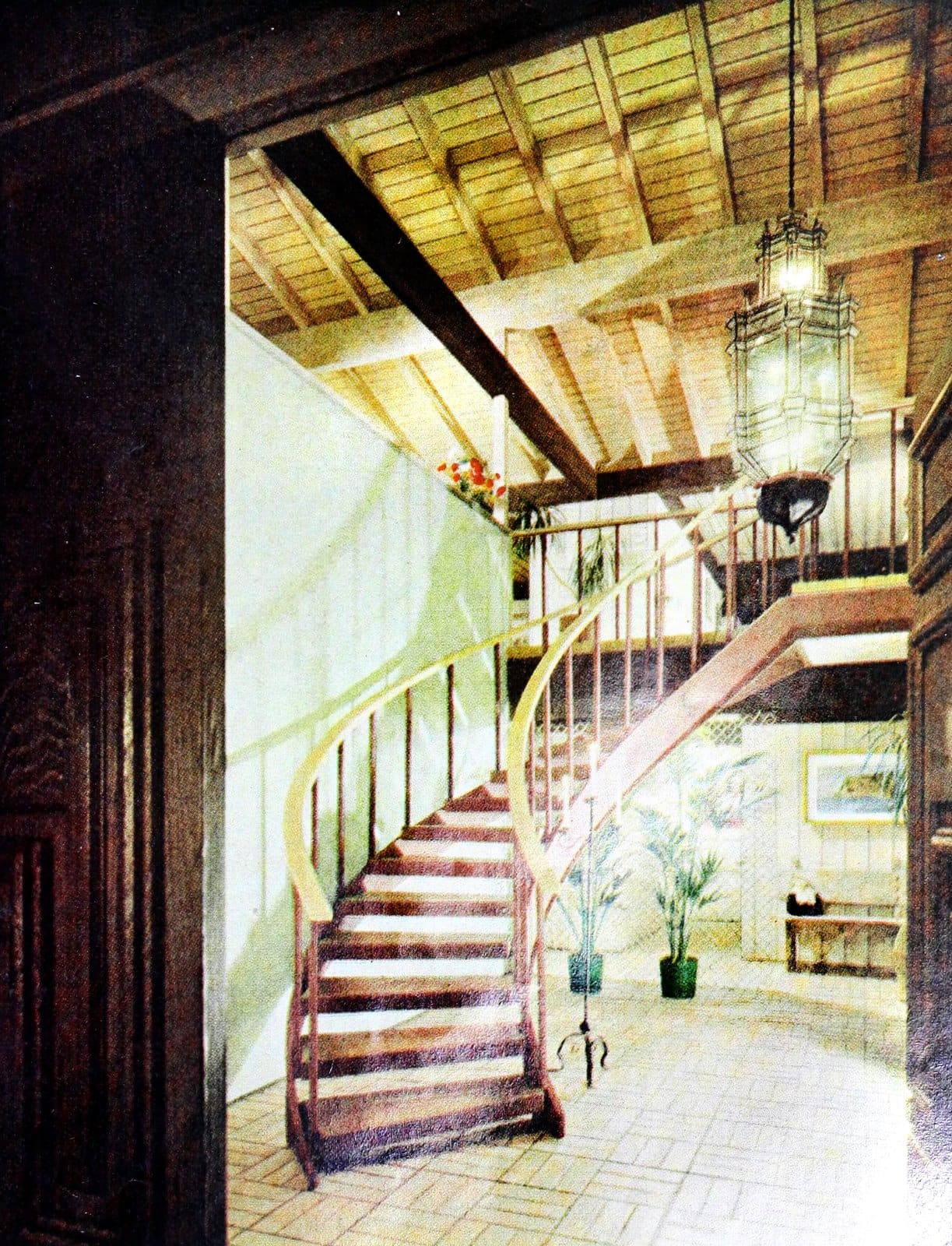 Entry hall with a curving staircase leading to the living room (1966)