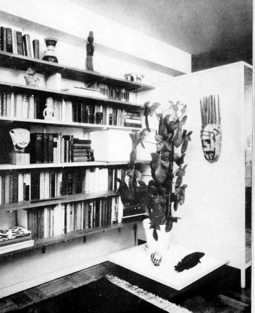 Entryway with colorful books and pottery from 1959