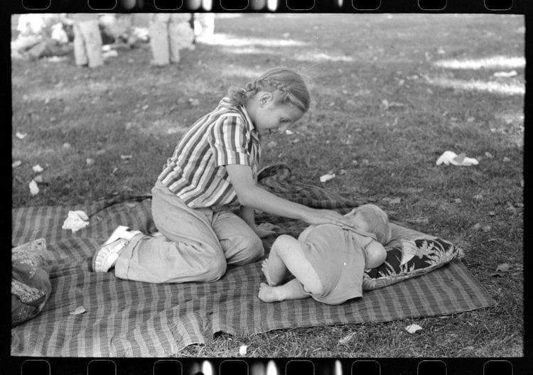 Even at a Fourth of July picnic baby brother must have his nap, Vale, Oregon 1941