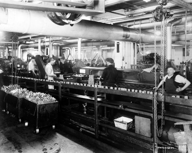 Factory workers on assembly line for bearings 1924