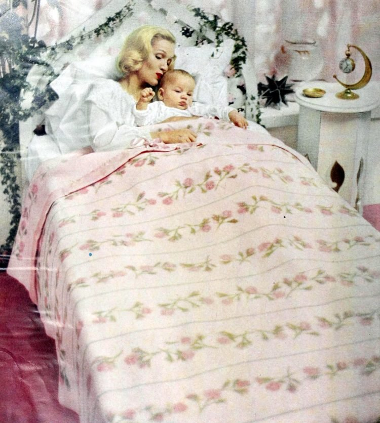 Fifties mom with baby in single twin bed