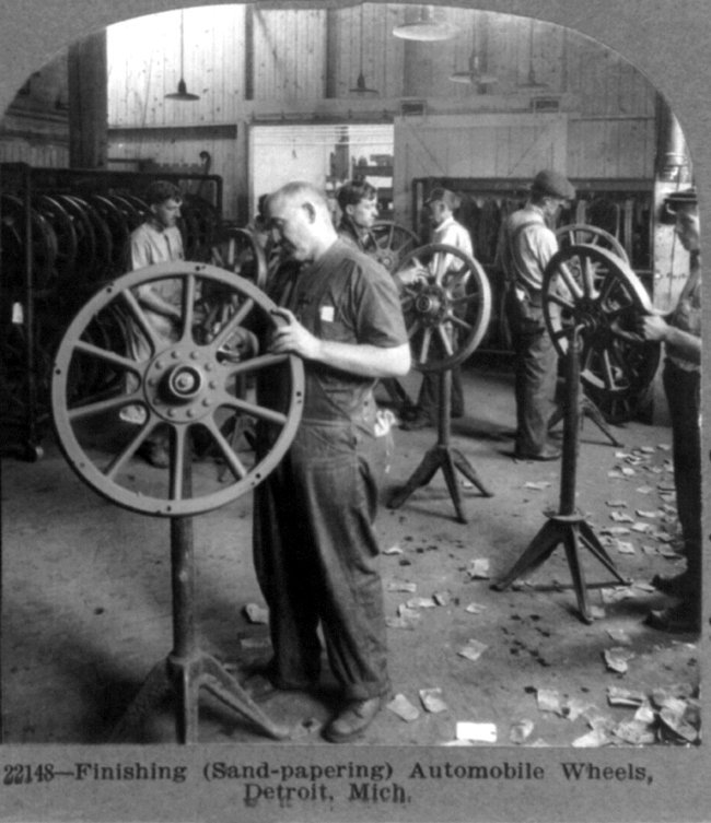 Finishing (sand-papering) automobile wheels, Detroit, Mich.