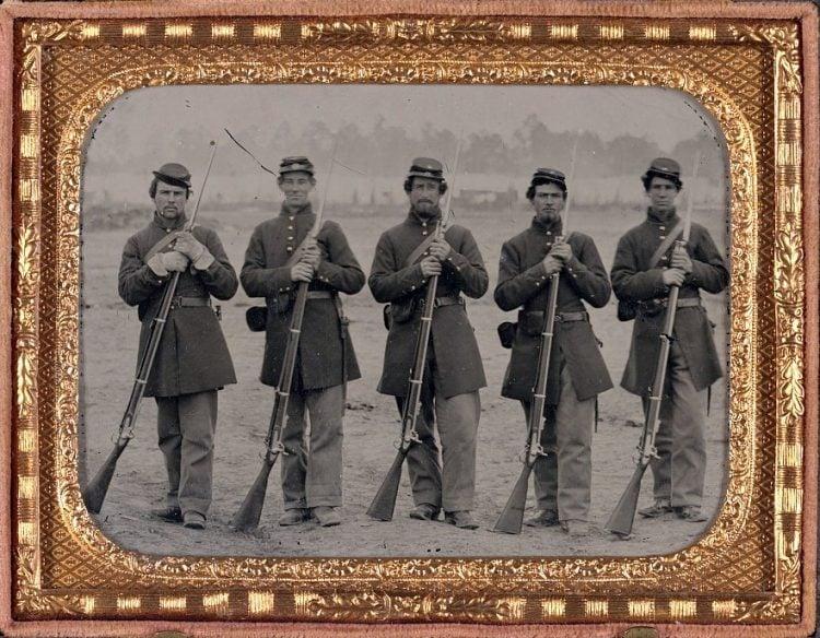 Five soldiers, four unidentified, in Union uniforms of the 6th Regiment Massachusetts Volunteer Militia