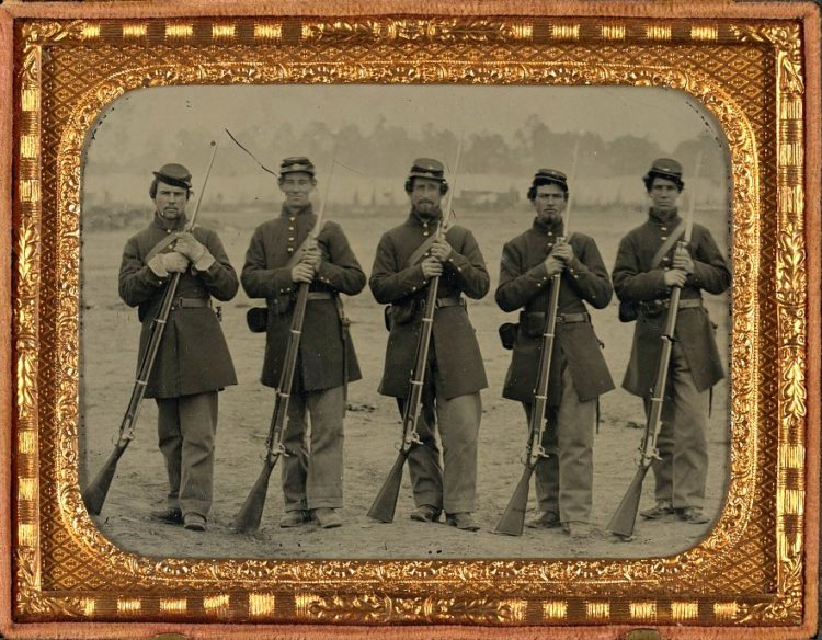 Five soldiers, four unidentified, in Union uniforms of the 6th Regiment Massachusetts Volunteer Militia