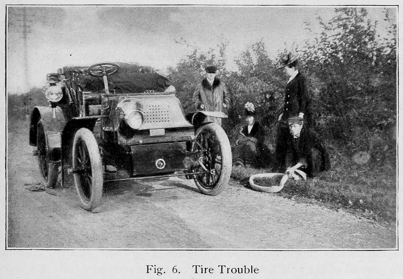 Flat tire on an early vintage motorcar (1901)