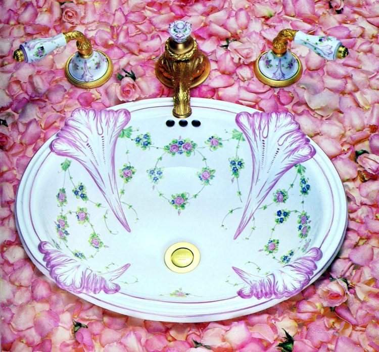 Floral painted sink with fancy faucets from the 1980s