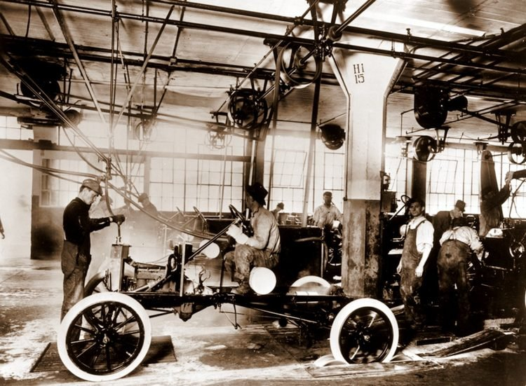 Ford assembly lines from 100 years ago, mass-producing Model T cars