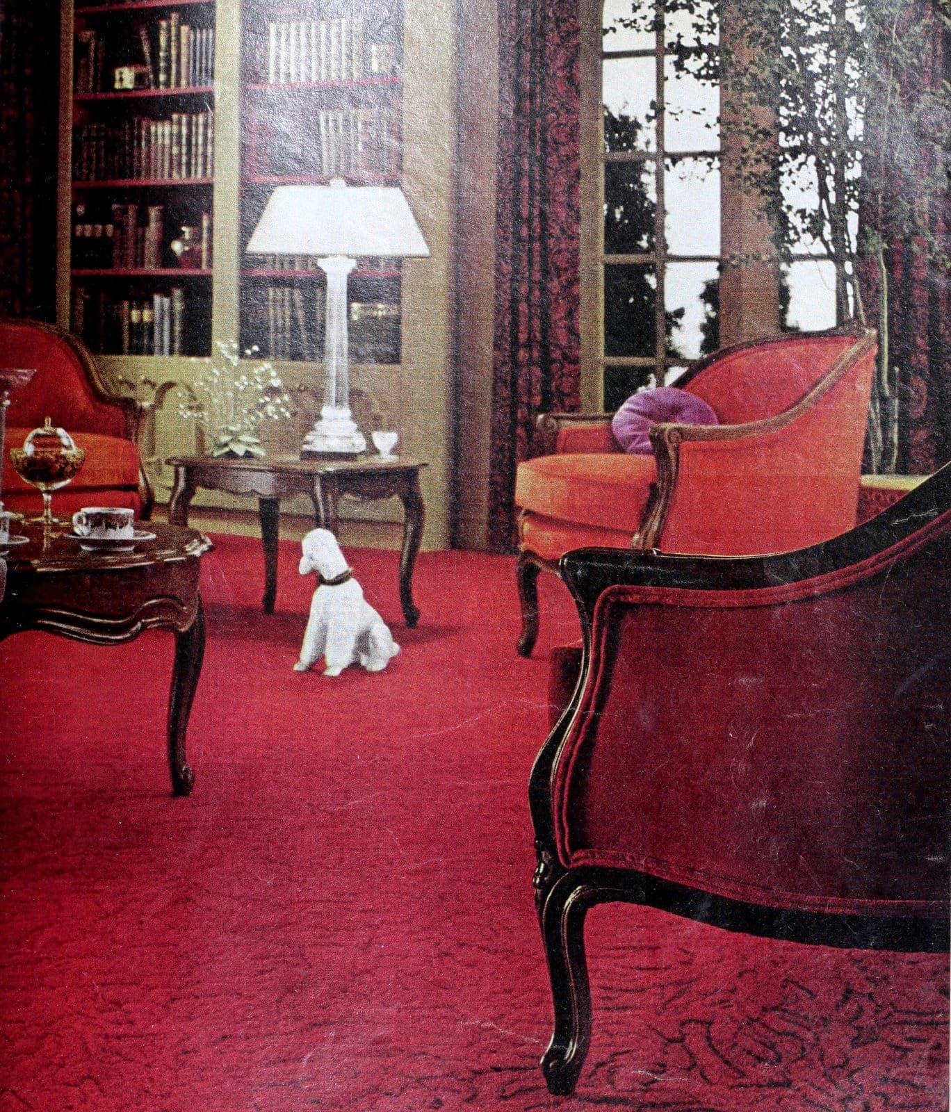 Formal vintage 60s living room with deep red carpet and furniture (1969)
