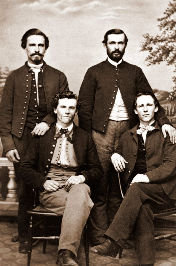 Four unidentified men in front of painted backdrop 1860
