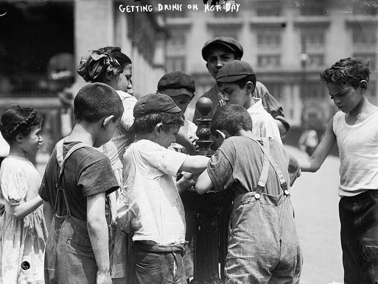 Getting drinks on hot day 1911