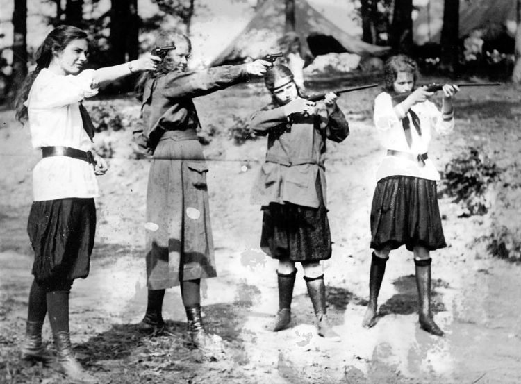 Girl Scouts learning to shoot guns - 1920s