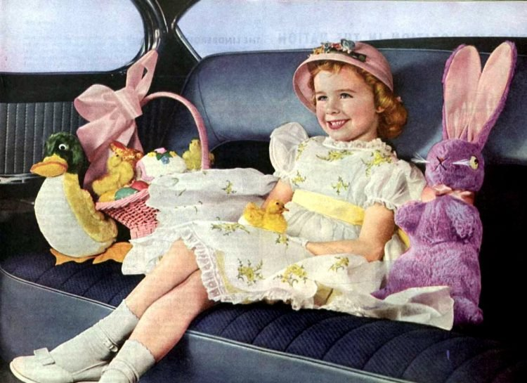 Girl in the '50s with Easter treats and toys