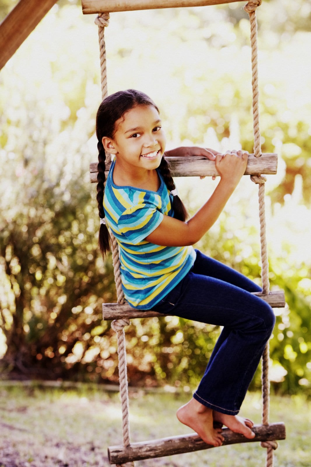 Girl on a treehouse rope ladder